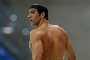 200m butterfly: Michael Phelps leaves the pool after winning the silver