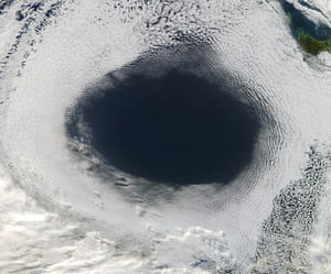 Satellite eye on earth: oval-shaped hole from a blanket of marine stratocumulus clouds