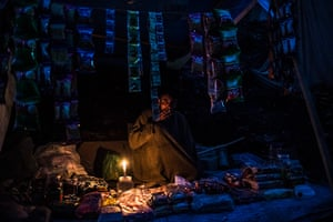 FTA: Daniel Berehulak: A Kashmiri shopkeeper sells his wares out of a tent near the Amarnath Cave