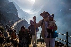 FTA: Daniel Berehulak: Hindu pilgrims walk along a mountain trail during their pilgrimage