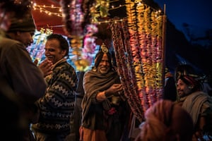 FTA: Daniel Berehulak: Hindu holy men and pilgrims celebrate at a campsite during their pilgrimage