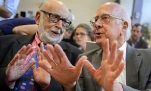 Peter Higgs (right) speaks with fellow physicist François Englert at Cern