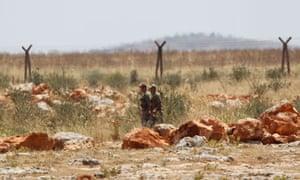 Turkish soldiers patrol Syria border