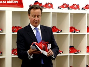 David Cameron inspects a size 17 trainer during a visit to the Team GB base in Loughborough on 5 July 2012.