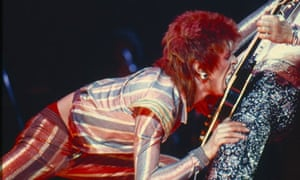 David Bowie kisses MIck Ronson's guitar, 1973