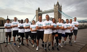 South Africa's Oscar Pistorius stands before Tower Bridge with some of the world's top Paralympians