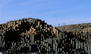 Stacks of largely hexagonal basalt rock form the Giant's Causeway, Northern Ireland.