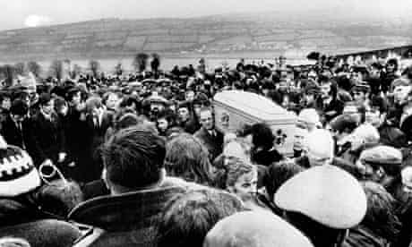 Pallbearers carry one of 13 coffins of Bloody Sunday victims