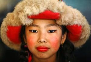 Picture Desk Live: Tibetan girl dressed in traditional attire