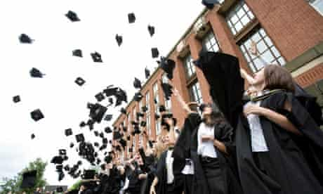 Mortar boards fly through the air as Law graduates celebrate