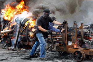 Picture Desk Live: Spanish miners burn tires to cut a road