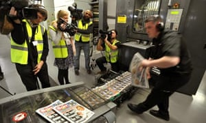 Camera crews film the first copies of the Sun on Sunday rolling off the presses at Broxbourne