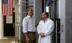 President Obama with an employee during a tour of Summer Garden Food Manufacturing in Boardman, Ohio