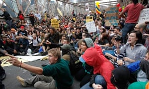 Occupy Wall Street Protesters react as police start arrests on the Brooklyn Bridge during a protest