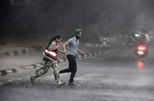 Picture desk live: Commuters run for cover during monsoon rain