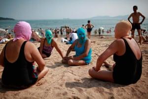 Picture desk live: Women, wearing nylon masks as they sunbathe