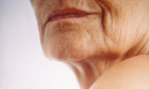 Woman's chin and shoulder