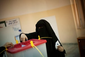 Libya Elections: A Libyan woman votes at a polling station in the old city of Tripoli