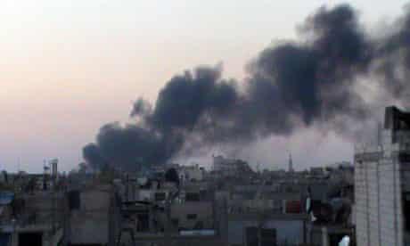 Smoke rises from buildings in Kerkenez, near Idlib