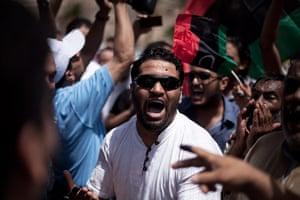 Libya election: A Libya man chants revolutionary slogans while celebrating