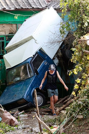 Russia Floods: A vehicle damaged by floods in the town of Krymsk