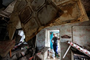 Russia Floods: A local resident looks at the debris of a house damaged by floods in Krymsk