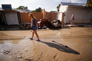 Russia Floods: A woman walks in a muddy street in the Black Sea resort of Gelendzhik