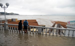 Russia Floods: People stand in flood water on the flooded seafront in Gelendzhik