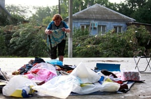 Russia Floods: A local resident lays out her belongings on the ground in Krymsk