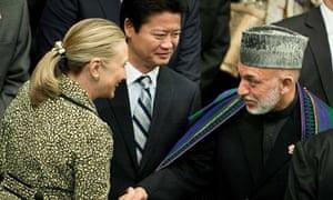 Hillary Clinton greets Hamid Karzai