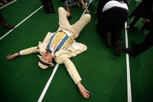 Chap Olympiad 2012: A competitor collapses at the finish line of the Ironing Board Surfing race