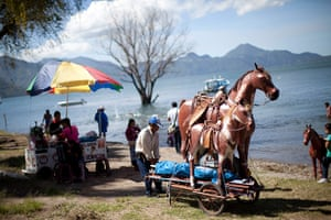 24 hours: Panajachel, Guatemala: A commercial photographer pulls his prop horses