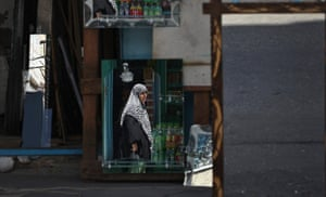 24 hours: Jabaliya, Gaza Strip: A Palestinian woman is reflected in mirrors for sale