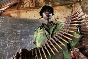 24 hours: Bunagana: A Congolese rebel fighter shows arms captured from fleeing army