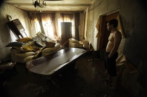 24 hours: Krymsk, Russia: A local man inspects his flooded house