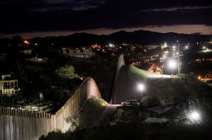 24 hours: Nogales, Arizona: The border wall is illuminated at night
