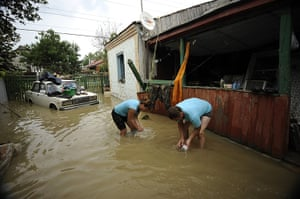 Russia floods: Local people work amidst the debris of a house in Krymsk