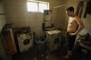 Russia floods: A local man inspects his flooded house in Krymsk