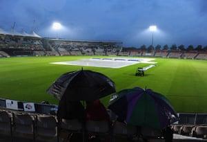 Summer rain: Hampshire v Sussex spectators in the rain