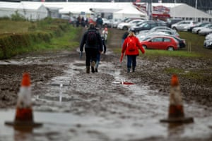 Summer rain: Formula 1 fans walk past puddles on their way to Silverstone circuit