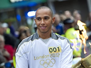 Lewis Hamilton carrying the Olympic torch in Luton on 9 July 2012.