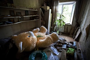24 hours: Krymsk, Russia: A teddy bear left inside a flooded house after flooding