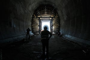 24 hours: Labourers stand inside a tunnel at the site of high speed rail