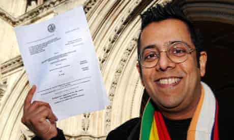 Science writer Simon Singh smiles outside the high court, London after winning his legal battle