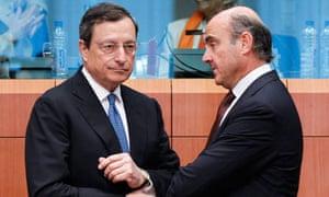 European Central Bank president Mario Draghi talks to Spanish economy minister Luis de Guindos