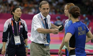 Olympic badminton head referee Torsten Berg issues a black card to both teams during a doubles match