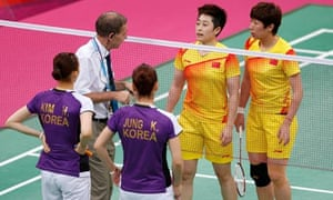 Olympic referee Torsten Berg warns players from China and South Korea during their badminton match
