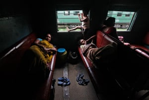 India blackout ends: Passengers rest inside a train while waiting for electricity to be restored