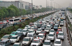 India blackout ends: Heavy traffic moves along a busy road as it rains during a powercut