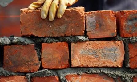 Labourer lays bricks